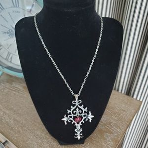Silver toned scrolled cross necklace